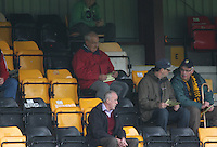 Former Huntly player Ian Robb reading the programme pre match at the Huntly v Wigtown & Bladnoch William Hill Scottish Cup 1st Round match, at Christie Park, Huntly on 25.8.12.
