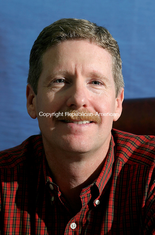 WATERBURY, CT - 23 September 2004 - 092304TH04 -  Paul Largay, President of Largay Travel Inc. in Waterbury, is one of eight U.S. travel agents selected to participate in the Travel Channel's new series, 'Vacation Challenge'.   Todd Hougas photo