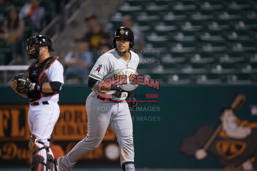 Salt Lake Bees catcher Jose Briceno (10) jogs towards the dugout after hitting a home run during a Pacific Coast League game against the Fresno Grizzlies at Chukchansi Park on May 14, 2018 in Fresno, California. Fresno defeated Salt Lake 4-3. (Zachary Lucy/Four Seam Images)