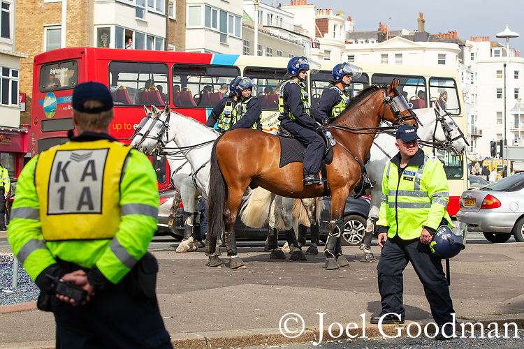 © Joel Goodman - 07973 332324 . 02/06/2012 . Brighton , UK . Groups of nationalists , including supporters of March for England and the EDL , congregate in Brighton as anti-fascist and left-wing campaigners supporting UK Uncut also congregate . An intensive policing operation is deployed to separate opposing left and right wing groups . Photo credit: Joel Goodman