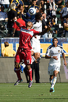 Collins John of Chicago Fire battles with Omar Gonzalez of the LA Galaxy. The Chicago Fire beat the LA Galaxy 3-2 at Home Depot Center stadium in Carson, California on Sunday August 1, 2010.