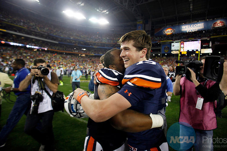 10 JAN 2011:  Neil Caudle (19) and Eric Smith (32) of Auburn University celebrate their win over the University of Oregon during the Tostitos BCS National Championship held at University of Phoenix Stadium in Glendale, AZ.  Auburn defeated Oregon 22-19 to win the national title.  Jamie Schwaberow/NCAA Photos