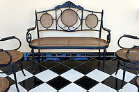 Ornate metal and wicker furniture in the Mansion Merida hotel, Merida, Yucatan, Mexico