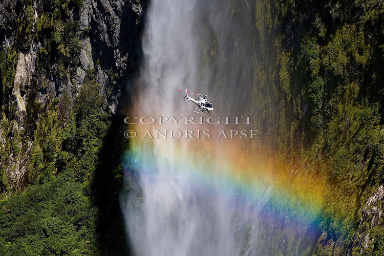 Helicopter in front of waterfall. Fiordland national Park.New Zealand.