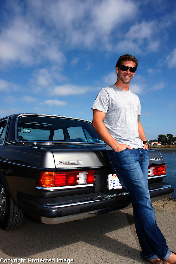 September 1, 2008, Labor Day.  Ocean Beach, San Diego, CA.   Point Loma native Nick Fletcher stands next to the car that he converted to run on vegetable oil.  Besides the savings in fuel costs, Fletcher says that he converted the car because he also wanted to do his part to help the environment.