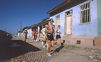 07 FEB 2003 - TRINIDAD, CUBA - Ruta Ecologica participants run through the streets of Trinidad, one of Cubas oldest cities. (PHOTO (C) NIGEL FARROW)