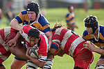 T. Masters protects the ball from the grasp of C. Mooney. Counties Manukau Rugby Union Premier round 7  game between Patumahoe & Karaka played at Patumahoe on May 26th 2007. Karaka led 5 - 3 at halftime and went on to win 12 - 3.