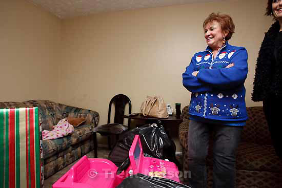 Gloria Boberg, executive director of The Ark of Little Cottonwood, delivered Christmas presents to Margarita Gonzales and her three children, Alexis Botello Gonzales, Oscar Botello Gonzales and Heidi Botello Gonzales, Tuesday, December 22, 2009.