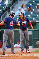 Lehigh Valley IronPigs second baseman Emmanuel Burriss (9) shakes hands with Taylor Featherston (6) after a home run during a game against the Buffalo Bisons on July 9, 2016 at Coca-Cola Field in Buffalo, New York.  Lehigh Valley defeated Buffalo 9-1 in a rain shortened game.  (Mike Janes/Four Seam Images)