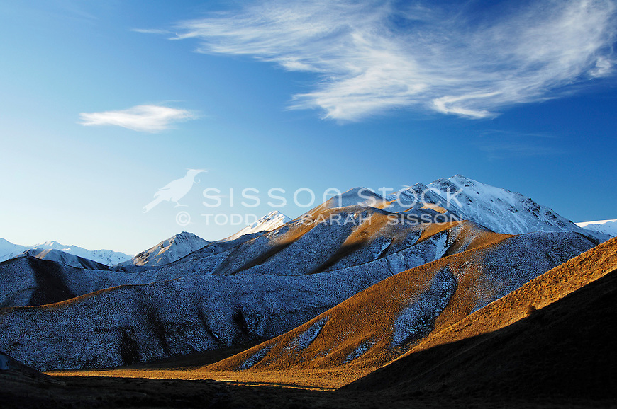 Snow covered hills in the Lindis Pass, late afternoon, Central Otago