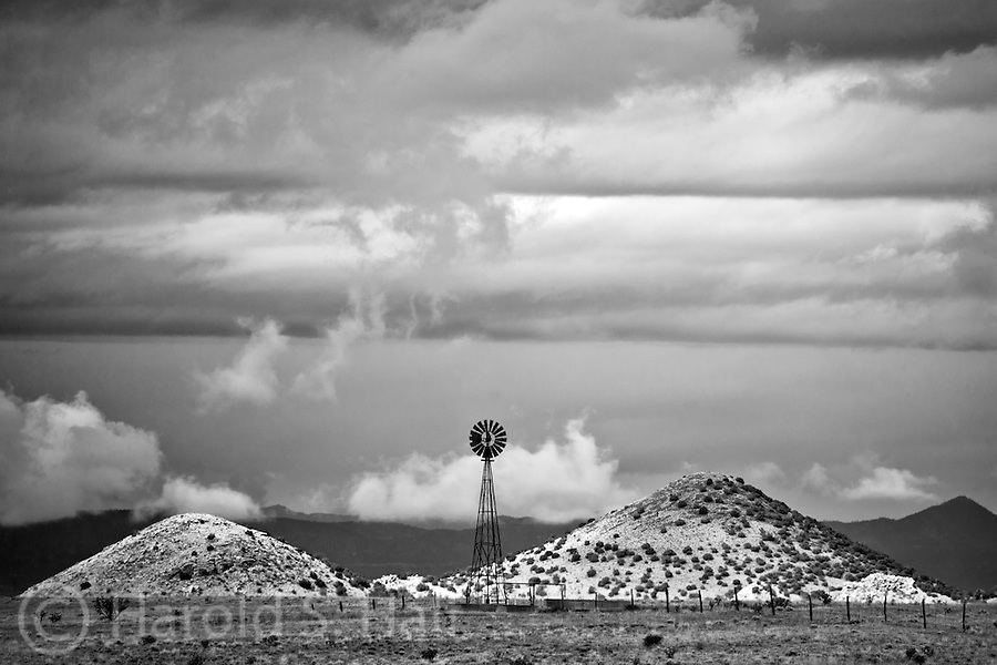 A lone windmill stands outside Of Santa Fe, New Mexico