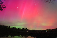 The northern lights radiates in the sky over the rivanna river 2003 in Charlottesville, Va.