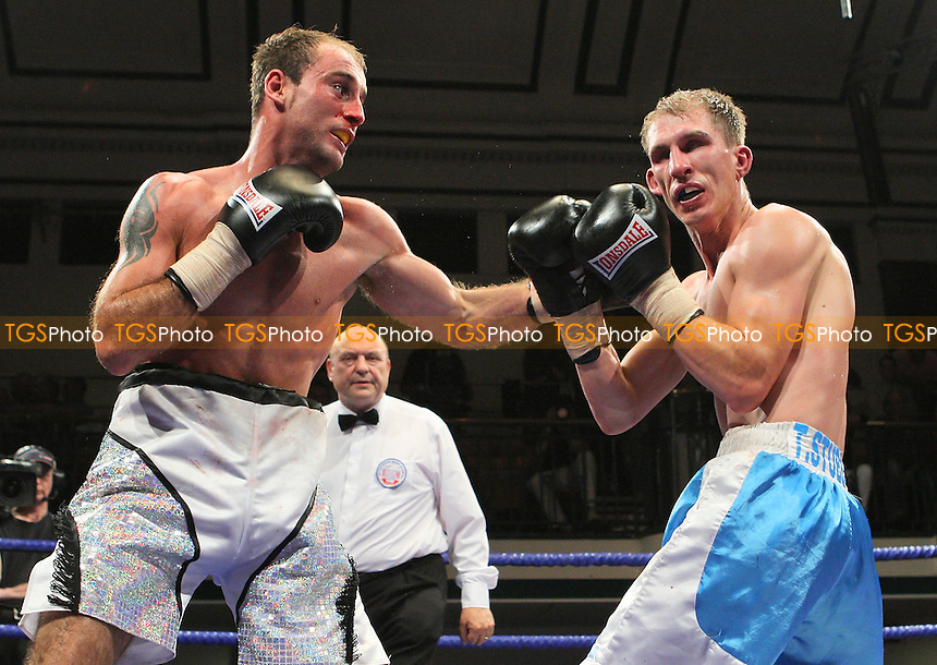 Ben Jones (silver shorts) draws with Gavin Reid in a Featherweight boxing contest at York Hall, Bethnal Green, promoted by Matchroom Sports / Barry Hearn - 18/09/09 - MANDATORY CREDIT: Gavin Ellis/TGSPHOTO - Self billing applies where appropriate - Tel: 0845 094 6026