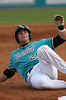 Adam Rice #29 of the Coastal Carolina University Chanticleers sliding into third base in a game against the University of Michigan Wolverines at the Carvelle Resort Classic Tournament held at Watson Stadium at Vrooman Field in Conway,, SC on March 13, 2010. Photo by Robert Gurganus/Four Seam Images