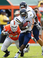Florida International University Golden Panthers (0-2, 0-0 SBC)  versus the University of Miami Hurricanes (1-1, 0-0 ACC) at the Orange Bowl, Miami, Florida on Saturday, September 15, 2007.  The Hurricanes defeated the Golden Panthers, 23-9...FIU junior running back A'mod Ned (3) (Miami, Fla.) picks up some yardage in the first quarter.