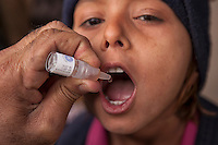 A child receives a polio vaccine in Karachi, Pakistan on Jan. 08, 2014