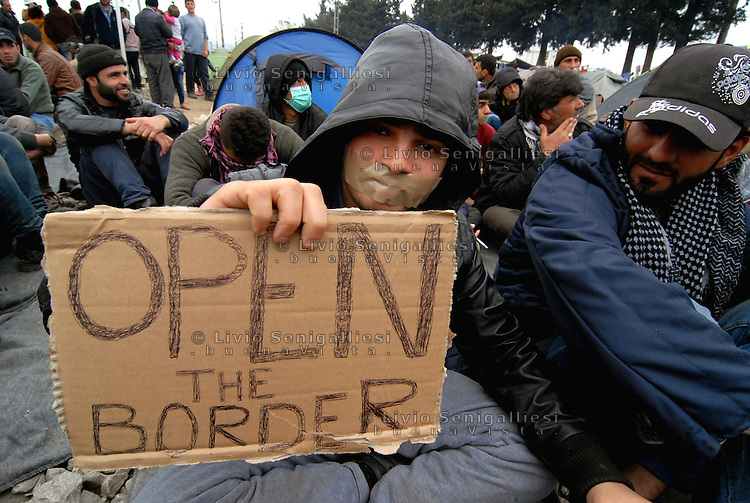 Idomeni / Greece 03/04/2016<br /> Refugees blocked the railway line crossing Idomeni camp to request the opening of borders. <br /> Photo Livio Senigalliesi