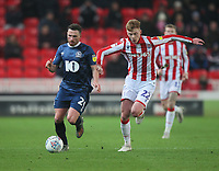 Blackburn Rovers Corry Evans in action with Stoke City's Sam Clucas<br /> <br /> Photographer Mick Walker/CameraSport<br /> <br /> The EFL Sky Bet Championship - Stoke City v Blackburn Rovers - Saturday 30th November 2019 - bet365 Stadium - Stoke-on-Trent<br /> <br /> World Copyright © 2019 CameraSport. All rights reserved. 43 Linden Ave. Countesthorpe. Leicester. England. LE8 5PG - Tel: +44 (0) 116 277 4147 - admin@camerasport.com - www.camerasport.com
