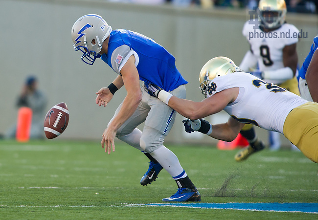 Oct. 26, 2013; Ben Councell (30) forces Air Force Falcons quarterback Nate Romine (6) to fumble in the third quarter.