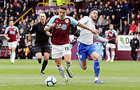 Burnley's Ashley Westwood under pressure from Cardiff City's Lee Peltier<br /> <br /> Photographer Rich Linley/CameraSport<br /> <br /> The Premier League - Saturday 13th April 2019 - Burnley v Cardiff City - Turf Moor - Burnley<br /> <br /> World Copyright © 2019 CameraSport. All rights reserved. 43 Linden Ave. Countesthorpe. Leicester. England. LE8 5PG - Tel: +44 (0) 116 277 4147 - admin@camerasport.com - www.camerasport.com