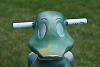 Duck antique cast aluminum spring ride in park near public swimming pool