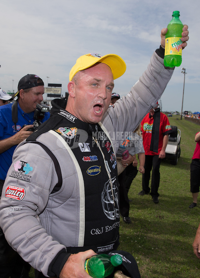 Apr. 28, 2013; Baytown, TX, USA: NHRA top fuel dragster driver Bob Vandergriff Jr celebrates after winning the Spring Nationals at Royal Purple Raceway. Mandatory Credit: Mark J. Rebilas-