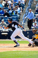 New York Yankees outfielder Juan Rivera #54 during a Spring Training game against the Pittsburgh Pirates at Legends Field on March 28, 2013 in Tampa, Florida.  (Mike Janes/Four Seam Images)