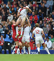 England's Thomas Powell claims a high ball under pressure from Wales's Jevon Groves<br /> <br /> Wales Vs England - men's classification 5th - 6th place match<br /> <br /> Photographer Chris Vaughan/CameraSport<br /> <br /> 20th Commonwealth Games - Day 4 - Sunday 27th July 2014 - Rugby Sevens - Ibrox Stadium - Glasgow - UK<br /> <br /> © CameraSport - 43 Linden Ave. Countesthorpe. Leicester. England. LE8 5PG - Tel: +44 (0) 116 277 4147 - admin@camerasport.com - www.camerasport.com