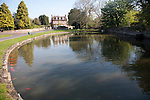 Village duck pond and historic house Urchfont, Wiltshire, England