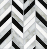 Errol, a stone mosaic, shown in Thassos, Calacatta Tia, Thassos,  and Nero Marquina, is part of the Ann Sacks Beau Monde collection sold exclusively at www.annsacks.com