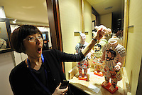 HONG KONG - MARCH 12:  Exhibitor Fonny Shum playfully demonstrates how the head can come off in the sculptures 'Mickey Mouse - Donald Duck' by artists Liu Fenghua and Liu Yong, represented by gallery Tanya Baxter, as part of the Asia Contemporary Art show that takes place in the bedrooms of Conrad hotel on March 12, 2015 in Hong Kong, Hong Kong.  (Photo by Lucas Schifres/Getty Images)