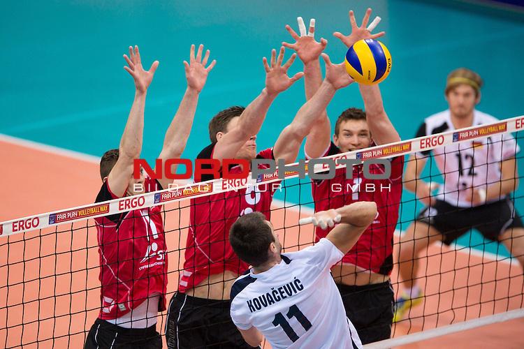 03.01.2014, MHP Arena, Ludwigsburg<br /> Volleyball, Qualifikation WM 2014, Deutschland vs. Kroatien<br /> <br /> Block  / Dreierblock Lukas Kampa (#11 GER), Marcus B&ouml;hme / Boehme (#8 GER), Christian Fromm (#1 GER) - Angriff Toni Kovacevic (#11 CRO)<br /> <br />   Foto &copy; nordphoto / Kurth