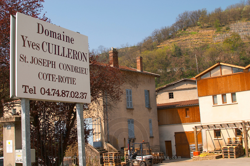 The winery, a sign indicting the place and in the background a vineyard in Condrieu. Domaine Yves Cuilleron, Chavanay, Ampuis, Rhone, France, Europe