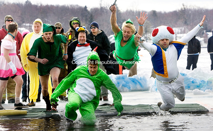 WINSTED CT. 08 February 2014-020814SV09-Matthew Smith&rsquo;s Mario Party Team takes the plunge into Highland Lake during the annual fundraiser for the Special Olympics in Winsted Saturday. Smith&rsquo;s team raised over $32,000 this year for Special Olympics.<br /> Steven Valenti Republican-American