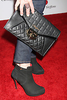 HOLLYWOOD, CA - AUGUST 02: Close up of Sarah Rafferty's Purse at the Carmen Steffens U.S. west coast flagship store opening at Hollywood & Highland Center on August 2, 2012 in Hollywood, California. ©mpi26/ MediaPunch Inc. /NortePhoto.com<br /> <br /> **SOLO*VENTA*EN*MEXICO**<br /> **CREDITO*OBLIGATORIO** <br /> *No*Venta*A*Terceros*<br /> *No*Sale*So*third*<br /> *** No Se Permite Hacer Archivo**<br /> *No*Sale*So*third*