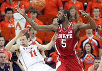North Carolina State forward C.J. Leslie (5) fouls Virginia forward Evan Nolte (11) during the game Saturday in Charlottesville, VA. Virginia defeated NC State 58-55.
