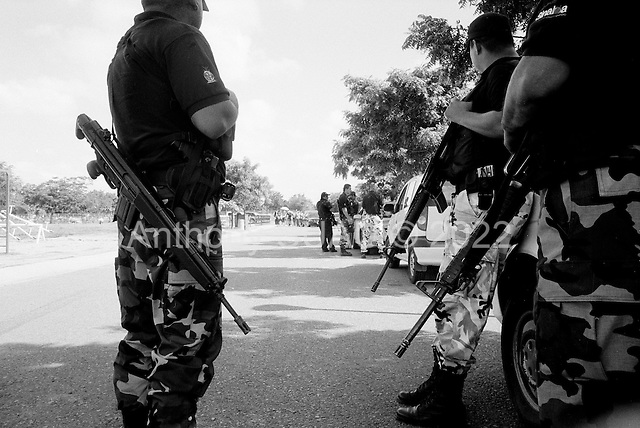 Culiacan, Sinaloa.Mexico.July 6, 2008..Family and friends along side dozens of armed policeman attend the funeral for a state police commander in San Martin cemetery. The commander was killed by narco hit-men during Friday rush hour on a main city intersection. From January 1 to mid-July 2008 there have been 535 drug related killings in Sinolao, many of them were police officers..