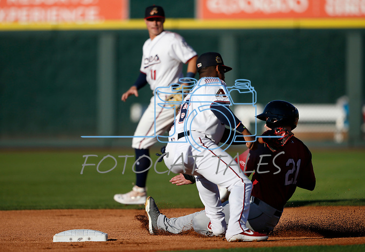 Reno Aces' Domingo Leyba tags out Sacramento River Cats' Mike Gerber during a game in Reno, Nev., on Thursday, July 4, 2019.<br /> Photo by Cathleen Allison/Nevada Momentum