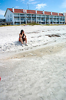 Woman sitting on Gulf of Mexico beach.  Indian Shores Tampa Bay Area Florida USA