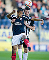 Falkirk's Lyle Taylor and Pars' Andy Dowie challenge for the ball  ...