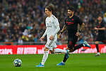 Luka Modric of Real Madrid and Ever Banega of Sevilla FC during La Liga match between Real Madrid and Sevilla FC at Santiago Bernabeu Stadium in Madrid, Spain. January 18, 2020. (ALTERPHOTOS/A. Perez Meca)