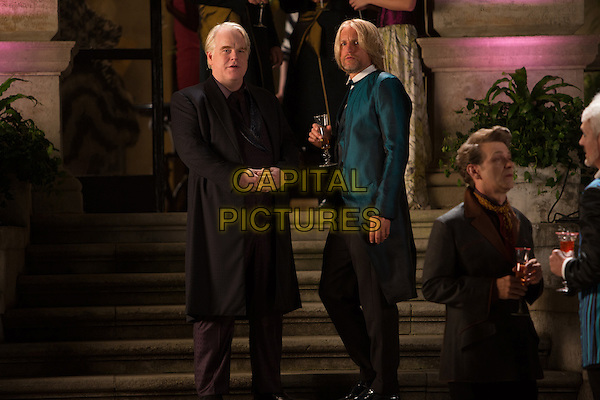Philip Seymour Hoffman, Woody Harrelson<br /> in The Hunger Games: Catching Fire (2013) <br /> *Filmstill - Editorial Use Only*<br /> CAP/FB<br /> Image supplied by Capital Pictures