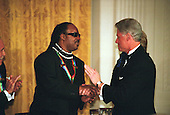 1999 Kennedy Center Honoree Stevie Wonder is congratulated by Presient Clinton at a White House reception hosted by the President and first lady Hillary Rodham Clinton in Washington, D.C. on December 5, 1999..Credit: Robert Trippett - Pool / CNP