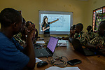 Conservationist, Xia Stevens, teaching anti-poaching scouts about SMART program, Sioma, western Zambia
