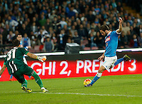Orestis Karnezis  make a save past  Jorginho  during the  italian serie a soccer match,between SSC Napoli and Udinese      at  the San  Paolo   stadium in Naples  Italy , November 08, 2015