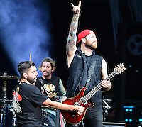 WEST PALM BEACH, FL - AUGUST 05: Singer Jeremy McKinnon, Musician Alex Shelnutt and Kevin Skaff of A Day To Remember perform at Perfect Vodka Amphitheatre on August 5, 2016 in West Palm Beach, Florida. Credit: MPI10 / MediaPunch
