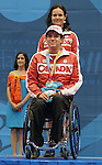 November 16 2011 - Guadalajara, Mexico:  Marco Dispaltro and his assistant Karin Sterkenburg after receiving his Silver Medal in Boccia BC4 in the Multipurpose Gymnasium Revolución at the 2011 Parapan American Games in Guadalajara, Mexico.  Photos: Matthew Murnaghan/Canadian Paralympic Committee