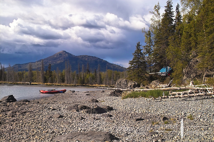 The tent is up, the boat is secure and the sun peeks below the clouds along Skilak Lake in Alaska's Kenai National Wildlife Refuge.