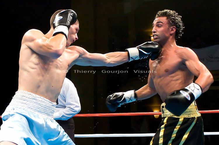 Paulie Malignaggi  (black trunk) on the defense against Jeremy Yelton during their 8 Rounds Jr. Welterweight fight at the Hammerstein Ballroom in New York, NY on 08.25.05.  Malignaggi won by Unanimous decision.