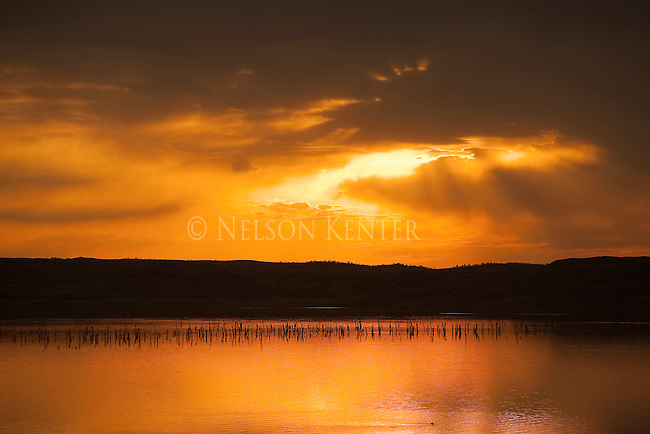 The sun's rays through clouds over the Missouri River above Fort Peck Reservoir in eastern Montana
